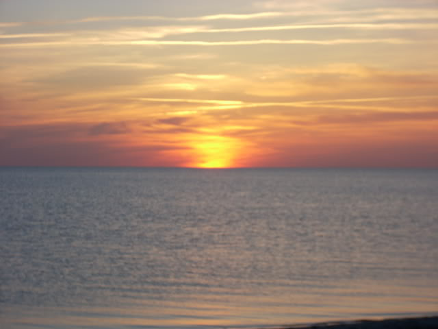 Group of the global healing center beautiful sunset over ocean