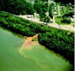 This is a photo of a river in Ohio where chemical pollutants are dumped by industrial waste openly, and without any Agency stopping such barbaric and wretched deception to the Consumer.