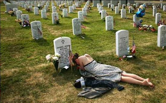 wife at grave of Iraq war casualty