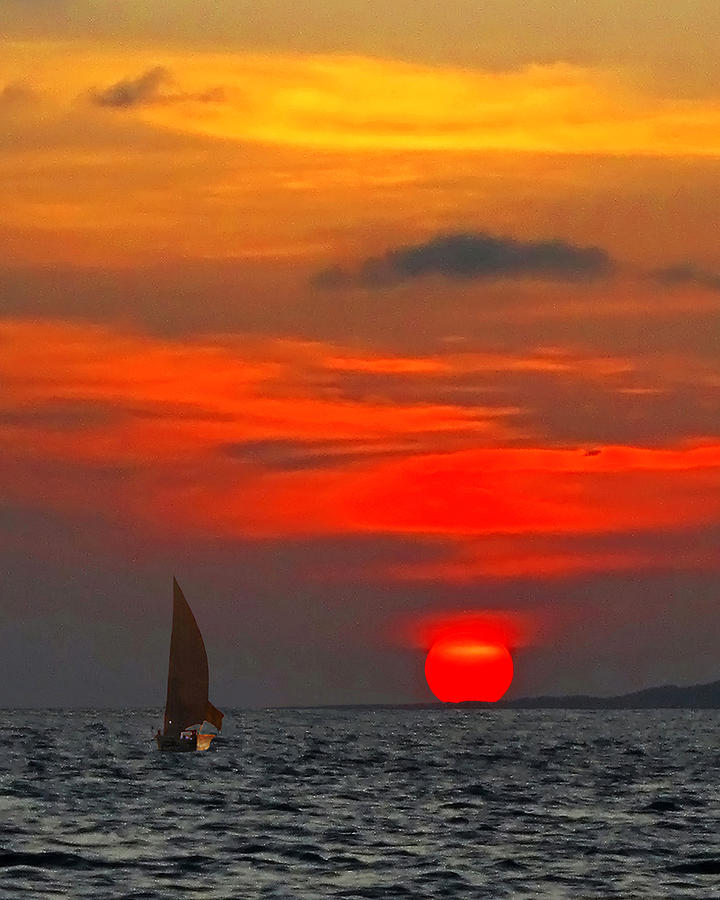 bright-orange-sunset-fishing-boat-silhouettes-david-schweitzer